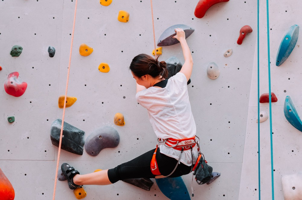 Woman climbing on a rock wall