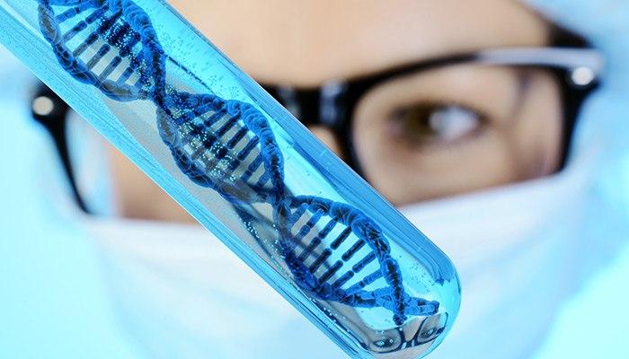 Test tube with large, blue DNA strand inside