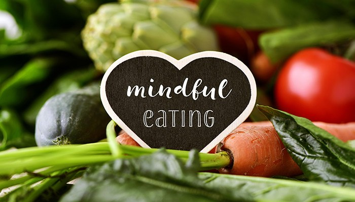 "Healthy garden foods with a heart in the middle that said ""mindful eating"" in the middle"