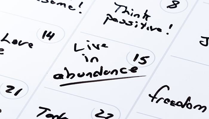 """Calendar that has the 15th day filled in with """"Live in abundance"""""""