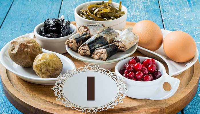 Thyroid rich foods in white dishes, on a blue table