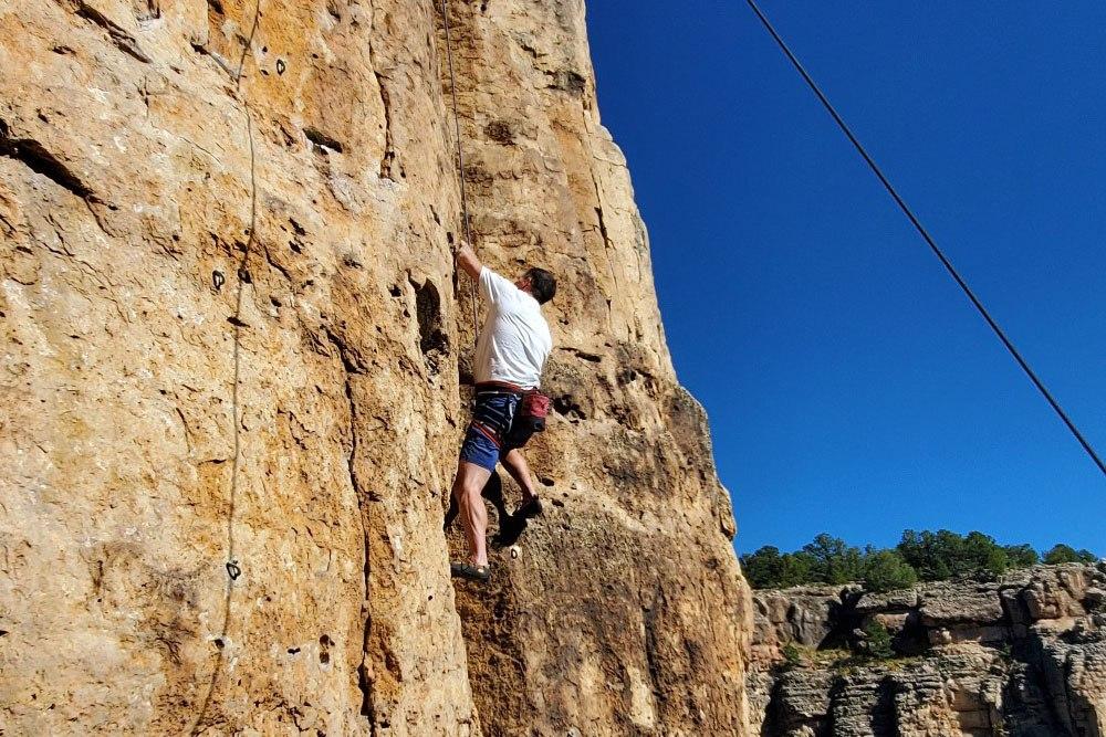 Doctor Morris rock climbing in Colorado